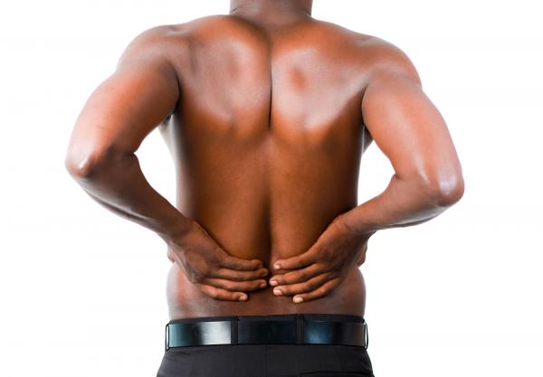 man suffering from lower back pain in fort worth, TX
